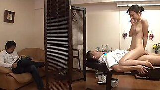 Wife cheating with masseur beside her husband