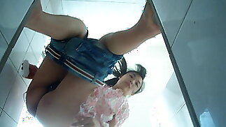 Close-up of Chinese girl peeing, filmer is discovered!