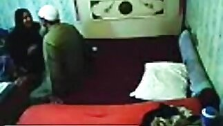 Voyeur tapes an arab hijab girl having missionary sex with a guy on the bed